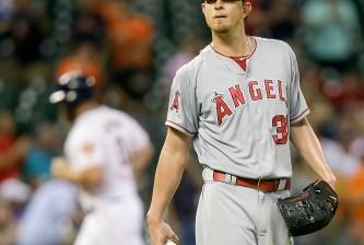 HOUSTON, TX - SEPTEMBER 21:  Jered Weaver #36 of the Los Angeles Angels of Anaheim reacts as Evan Gattis #11 of the Houston Astros riounds the bases on his home run in the second inning at Minute Maid Park on September 21, 2015 in Houston, Texas.  (Photo by Bob Levey/Getty Images)