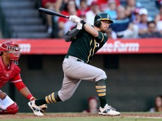 ANAHEIM, CA - SEPTEMBER 30: Eric Sogard #28 of the Oakland Athletics hits a three run double in the fourth inning against the Los Angeles Angels of Anaheim at Angel Stadium of Anaheim on September 30, 2015 in Anaheim, California.  (Photo by Stephen Dunn/Getty Images)