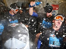 BALTIMORE, MD - SEPTEMBER 30: The Toronto Blue Jays celebrate in the clubhouse after defeating the Baltimore Orioles and clinching the AL East Division following game two of a double header at Oriole Park at Camden Yards on September 30, 2015 in Baltimore, Maryland. (Photo by Patrick Smith/Getty Images)