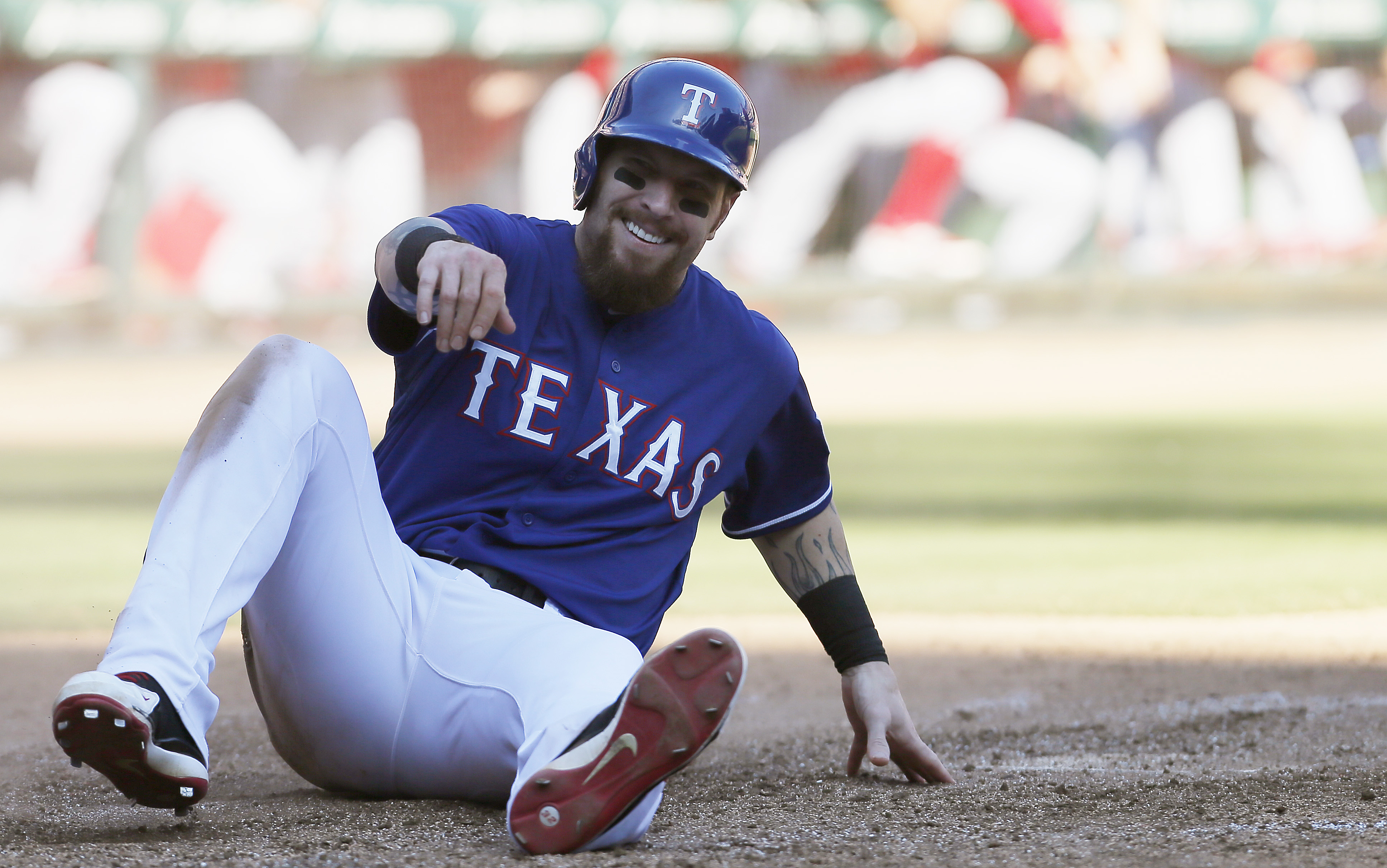 ARLINGTON, TX - OCTOBER 4: Josh Hamilton #32 of the Texas Rangers reacts after scoring a run on a Elvis Andrus RBI double during the seventh inning of a baseball game against the Los Angeles Angels at Globe Life Park on October 4, 2015 in Arlington, Texas. Texas won 9-2 and won the AL West Title. (Photo by Brandon Wade/Getty Images)