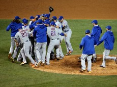 CHICAGO, IL - OCTOBER 21:  The New York Mets celebrate after defeating the Chicago Cubs in game four of the 2015 MLB National League Championship Series at Wrigley Field on October 21, 2015 in Chicago, Illinois.  The Mets defeated the Cubs with a score of 8 to 3 to sweep the Championship Series.  (Photo by Jon Durr/Getty Images)