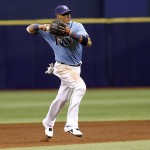 ST. PETERSBURG, FL - SEPTEMBER 21:  Shortstop Yunel Escobar #11 of the Tampa Bay Rays fields the ground out by Carlos Sanchez of the Chicago White Sox during the third inning of a game on September 21, 2014 at Tropicana Field in St. Petersburg, Florida.  (Photo by Brian Blanco/Getty Images)
