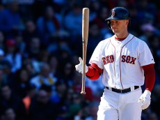 BOSTON, MA - APRIL 06: Daniel Nava #29 of the Boston Red Sox throws his bat in the air after striking out against the Milwaukee Brewers during the game at Fenway Park on April 6, 2014 in Boston, Massachusetts.  (Photo by Jared Wickerham/Getty Images)