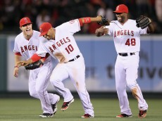 ANAHEIM, CA - APRIL 30:  (L-R) Mike Trout #27, Vernon Wells #10 and Torii Hunter #48 of the Los Angeles Angels of Anaheim celebrate their teams victory over the Minnesota Twins at Angel Stadium of Anaheim on April 30, 2012 in Anaheim, California. The Angels defeated the Twins 4-3.  (Photo by Jeff Gross/Getty Images)