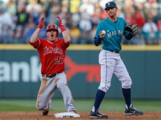 SEATTLE, WA - JULY 12:  Mike Trout #27 of the Los Angeles Angels of Anaheim reacts after being tagged out on a steal attempt at second base by second baseman Brad Miller #5 of the Seattle Mariners in the third inning at Safeco Field on July 12, 2013 in Seattle, Washington.  (Photo by Otto Greule Jr/Getty Images)