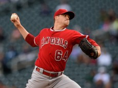 MINNEAPOLIS, MN - SEPTEMBER 19: Mike Morin #64 of the Los Angeles Angels of Anaheim delivers a pitch against the Minnesota Twins during the eleventh inning in the first game of a doubleheader on September 19, 2015 at Target Field in Minneapolis, Minnesota. The Angels defeated the Twins 4-3 in twelve innings. (Photo by Hannah Foslien/Getty Images)