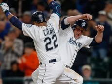 SEATTLE, WA - SEPTEMBER 29:  Robinson Cano #22 of the Seattle Mariners is congratulated by Kyle Seager #15 after hitting a two-run home run against the Houston Astros in the sixth inning at Safeco Field on September 29, 2015 in Seattle, Washington.  (Photo by Otto Greule Jr/Getty Images)