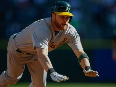 SEATTLE, WA - OCTOBER 04:  Craig Gentry #3 of the Oakland Athletics triples in the third inning against the Seattle Mariners at Safeco Field on October 4, 2015 in Seattle, Washington.  (Photo by Otto Greule Jr/Getty Images)