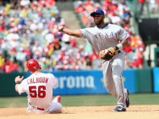ANAHEIM, CALIFORNIA - APRIL 10:  Shortstop Elvis Andrus #1 of the Texas Rangers throws to first after forcing out Kole Calhoun #56 of the Los Angeles Angels of Anaheim to complete a double play to end the sixth inning at Angel Stadium of Anaheim on April 10, 2016 in Anaheim, California.  (Photo by Stephen Dunn/Getty Images)