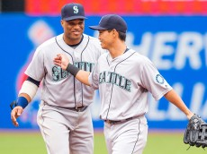 CLEVELAND, OH -  APRIL 21: Robinson Cano #22 celebrates with Norichika Aoki #8 of the Seattle Mariners after the Mariners defeated the Cleveland Indians 10-7 at Progressive Field on April 21, 2016 in Cleveland, Ohio. (Photo by Jason Miller/Getty Images)