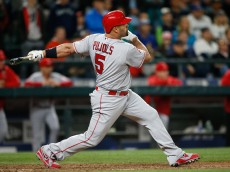 SEATTLE, WA - MAY 14: Albert Pujols #5 of the Los Angeles Angels of Anaheim hits a three-run home run against the Seattle Mariners in the ninth inning at Safeco Field on May 14, 2016 in Seattle, Washington. (Photo by Otto Greule Jr/Getty Images)