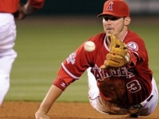 Los Angeles Angels third baseman Brandon Wood tosses the ball to second baseman Howard Kendrick to force out Los Angeles Dodgers' Casey Blake at second during the eighth inning of their baseball game, Tuesday, June 22, 2010, in Anaheim, Calif. Kendrick threw out Matt Kemp at first to complete the double play.  (AP Photo/Mark J. Terrill)