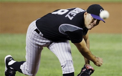 capt.ec1a13ab60934a15a1868894348c58f6.rockies_nationals_baseball_nat101