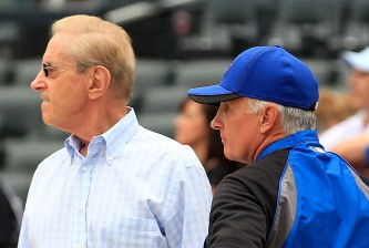 NEW YORK - AUGUST 06:  New York Mets Chief Executive Officer Fred Wilpon , Manager Terry Collins, prospective Mets owner David Einhorn and General Manager Sandy Alderson (L-R) talk during batting practice before a Major League Baseball game against the Atlanta Braves at Citi Field on August 6, 2011 in the Flushing neighborhood of the Queens borough of New York City.  (Photo by Paul Bereswill/Getty Images)