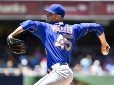 SAN DIEGO, CA - JULY 20:  Zack Wheeler #45 of the New York Mets pitches during the first inning of a baseball game  against the San Diego Padres at Petco Park July 20, 2014 in San Diego, California.  (Photo by Denis Poroy/Getty Images)