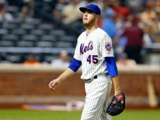NEW YORK, NY - AUGUST 27:  Zack Wheeler #45 of the New York Mets walks back to the dugout after the third inning against the Atlanta Braves at Citi Field on August 27, 2014 in the Flushing neighborhood of the Queens borough of New York City.  (Photo by Jim McIsaac/Getty Images)