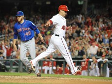 WASHINGTON, DC - SEPTEMBER 25:  Wilson Ramos #40 of the Washington Nationals scores on a Zack Wheeler #45 of the New York Mets passed ball in the fourth inning during game two of a doubleheader baseball game on September 25, 2014 at Nationals Park in Washington, DC.  (Photo by Mitchell Layton/Getty Images)