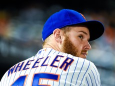 NEW YORK, NY - SEPTEMBER 17:  Zack Wheeler #45 of the New York Mets looks on during a game against the Miami Marlins at Citi Field on September 17, 2014 in the Flushing neighborhood of the Queens borough of New York City.  (Photo by Alex Goodlett/Getty Images)