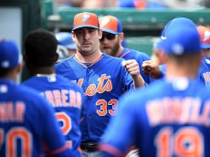 JUPITER, FL - MARCH 11:  Matt Harvey #33 of the New York Mets greets teammates in the dugout during the third inning of a spring training game against the Miami Marlins at Roger Dean Stadium on March 11, 2015 in Jupiter, Florida.  (Photo by Stacy Revere/Getty Images)