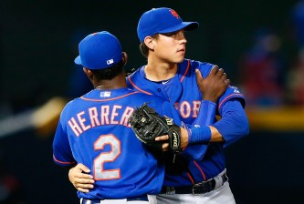 ATLANTA, GA - SEPTEMBER 19:  Dilson Herrera #2 and Wilmer Flores #4 of the New York Mets react after their 5-0 win over the Atlanta Braves at Turner Field on September 19, 2014 in Atlanta, Georgia.  (Photo by Kevin C. Cox/Getty Images)