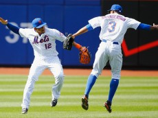 NEW YORK, NY - APRIL 19:  Juan Lagares #12 and Curtis Granderson #3 of the New York Mets celebrate a 7-6 win against the Miami Marlins during their game at Citi Field on April 19, 2015 in New York City.  (Photo by Al Bello/Getty Images)