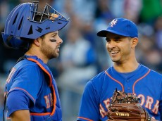 NEW YORK, NY - APRIL 25: Pitcher Carlos Torres #52 smiles as he talks with catcher Kevin Plawecki #22 of the New York Mets during a break in play in the ninth inning against the New York Yankees on April 25, 2015 at Yankee Stadium in the Bronx borough of New York City. (Photo by Nate Shron/Getty Images)