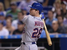 MIAMI, FL - APRIL 27: Daniel Murphy #28 of the New York Mets hits a three-run home run during the ninth inning of the game against the Miami Marlins at Marlins Park on April 27, 2015 in Miami, Florida.  (Photo by Rob Foldy/Getty Images)