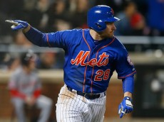 NEW YORK, NY - MAY 01:  Daniel Murphy #28 of the New York Mets reacts after hitting a three run double in the eighth inning against the Washington Nationals at Citi Field on May 1, 2015 in the Flushing neighborhood of the Queens borough of New York City.  (Photo by Mike Stobe/Getty Images)