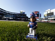 NEW YORK, NY - MAY 2: A garden gnome of New York Mets pitcher Jacob deGrom sits on the field prior to the start of a game against the Washington Nationals on May 2, 2015 at Citi Field in the Flushing neighborhood of the Queens borough of New York City. (Photo by Rich Schultz/Getty Images)