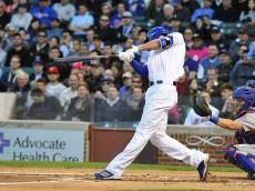 CHICAGO, IL - MAY 11: Kris Bryant #17 of the Chicago Cubs hits a two-run homer against the New York Mets on May 11, 2015 at Wrigley Field in Chicago, Illinois.  It was Bryant's first home run at Wrigley Field. (Photo by David Banks/Getty Images)