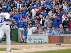 CHICAGO, IL - MAY 14: Fans react as Dexter Fowler #24 of the Chicago Cubs steals home plate against the New York Mets during the seventh inning on May 14, 2015 at Wrigley Field in Chicago, Illinois. The Chicago Cubs won 6-5. (Photo by Jon Durr/Getty Images)