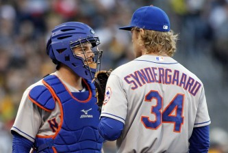 PITTSBURGH, PA - MAY 22:  Kevin Plawecki #22 of the New York Mets talks with Noah Syndergaard #34 of the New York Mets after giving up two runs in the second inning during the game against the Pittsburgh Pirates at PNC Park on May 22, 2015 in Pittsburgh, Pennsylvania.  (Photo by Justin K. Aller/Getty Images)