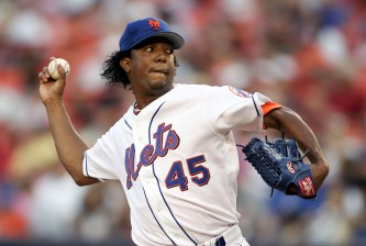 NEW YORK - AUGUST 3:  Pedro Martinez #45 of the New York Mets pitches against the Milwaukee Brewers during their game on August 3, 2005 at Shea Stadium in the Flushing neighborhood of the Queens borough of New York City.  (Photo by Al Bello/Getty Images)