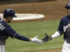MILWAUKEE, WI - JUNE 23:  Carlos Gomez #27 of the Milwaukee Brewers celebrates with Aramis Ramirez #16 after reaching on a double hit by Adam Lind in the seventh inning against the New York Mets at Miller Park on June 23, 2015 in Milwaukee, Wisconsin. (Photo by Mike McGinnis/Getty Images)