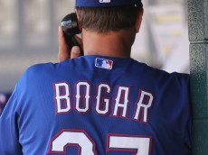 DETROIT, MI - MAY 25:  Texas Rangers bench coach Tim Bogar #27 talks on the phone to the teams video replay assistant during the game against the Detroit Tigers at Comerica Park on May 25, 2014 in Detroit, Michigan. The Rangers defeated the Tigers 12-4.  (Photo by Leon Halip/Getty Images)