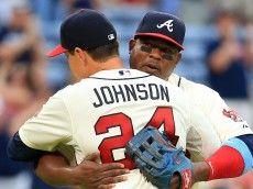 ATLANTA, GA - JUNE 21: Juan Uribe #2 celebrates with Kelly Johnson #24 of the Atlanta Braves after beating the New York Mets at Turner Field on June 21, 2015 in Atlanta, Georgia. (Photo by Daniel Shirey/Getty Images)