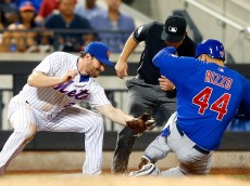 NEW YORK, NY - JULY 01:  Anthony Rizzo #44 of the Chicago Cubs steals third base in the ninth inning as Daniel Murphy #28 of the New York Mets misses the tag at Citi Field on July 1, 2015 in the Flushing neighborhood of the Queens borough of New York City.  (Photo by Jim McIsaac/Getty Images)