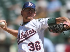 OAKLAND, CA - JULY 04:  Tyler Clippard #36 of the Oakland Athletics pitches against the Seattle Mariners in the top of the ninth inning at O.co Coliseum on July 4, 2015 in Oakland, California. The Athletics won the game 2-0. (Photo by Thearon W. Henderson/Getty Images)