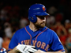 WASHINGTON, DC - JULY 20: Daniel Murphy #28 of the New York Mets walks off the field after flying out for the last out of their 7-2 loss to the Washington Nationals at Nationals Park on July 20, 2015 in Washington, DC.  (Photo by Rob Carr/Getty Images)