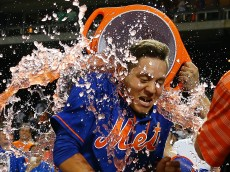 NEW YORK, NY - JULY 31:  Wilmer Flores #4 of the New York Mets celebrates after hitting a twelfth inning walk-off home run against the Washington Nationals at Citi Field on July 31, 2015 in Flushing neighborhood of the Queens borough of New York City. Mets defeated the Nationals 2-1 in 12 innings.  (Photo by Mike Stobe/Getty Images)