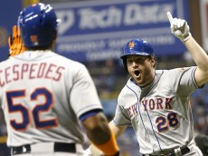 ST. PETERSBURG, FL - AUGUST 7:  Daniel Murphy #28 of the New York Mets celebrates his home run with teammate Yoenis Cespedes #52 during the eighth inning of a game against the Tampa Bay Rays on August 7, 2015 at Tropicana Field in St. Petersburg, Florida.  (Photo by Brian Blanco/Getty Images) *** Local Caption *** Daniel Murphy; Yoenis Cespedes