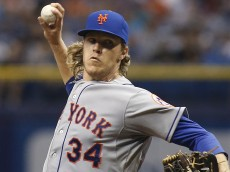 ST. PETERSBURG, FL - AUGUST 8:  Noah Syndergaard #34 of the New York Mets pitches during the first inning of a game against the Tampa Bay Rays on August 8, 2015 at Tropicana Field in St. Petersburg, Florida.  (Photo by Brian Blanco/Getty Images) *** Local Caption *** Noah Syndergaard