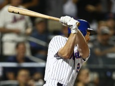 NEW YORK, NY - AUGUST 10: Daniel Murphy #28 of the New York Mets hits a two-run single against the Colorado Rockies during the seventh inning on August 10, 2015 at Citi Field in the Flushing neighborhood of the Queens borough of New York City. (Photo by Rich Schultz/Getty Images)