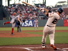 SAN FRANCISCO, CA - AUGUST 13:  Buster Posey #28 of the San Francisco Giants hits a single against Stephen Strasburg #37 of the Washington Nationals that scored Matt Duffy #5 of the San Francisco Giants in the first inning at AT&T Park on August 13, 2015 in San Francisco, California.  (Photo by Ezra Shaw/Getty Images)