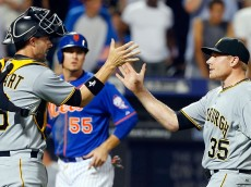 NEW YORK, NY - AUGUST 15:  Mark Melancon #35 and Chris Stewart #19 of the Pittsburgh Pirates celebrate after defeating the New York Mets at Citi Field on August 15, 2015 in the Flushing neighborhood of the Queens borough of New York City.  (Photo by Jim McIsaac/Getty Images)