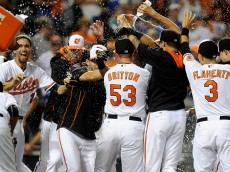 BALTIMORE, MD - AUGUST 19:  Henry Urrutia #51 of the Baltimore Orioles is doused with water by teammates after hitting the game winning home run in the ninth inning against the New York Mets at Oriole Park at Camden Yards on August 19, 2015 in Baltimore, Maryland. Baltimore won the game 5-4.  (Photo by Greg Fiume/Getty Images)