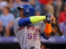 DENVER, CO - AUGUST 21:  Yoenis Cespedes #52 of the New York Mets hits a grand slam during the second inning against the Colorado Rockies at Coors Field on August 21, 2015 in Denver, Colorado. (Photo by Justin Edmonds/Getty Images)