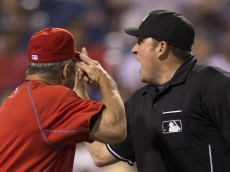 PHILADELPHIA, PA - AUGUST 25: Bench coach Larry Bowa #10 of the Philadelphia Phillies gets ejected after arguing with home plate umpire Dan Bellino #2 in the bottom of the seventh inning against the New York Mets on August 25, 2015 at the Citizens Bank Park in Philadelphia, Pennsylvania.  The Mets defeated the Phillies 6-5. (Photo by Mitchell Leff/Getty Images)