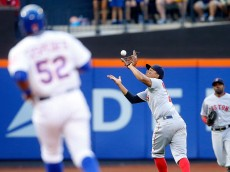 NEW YORK, NY - AUGUST 29:  Xander Bogaerts #2 of the Boston Red Sox makes a catch for the final out of the eighth inning against the New York Mets at Citi Field on August 29, 2015 in the Flushing neighborhood of the Queens borough of New York City.  (Photo by Jim McIsaac/Getty Images)