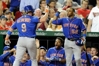 WASHINGTON, DC - SEPTEMBER 08:  Kirk Nieuwenhuis #9 of the New York Mets celebrates with Yoenis Cespedes #52 after hitting ended up being the game-winning home run in the eighth inning against the Washington Nationals at Nationals Park on September 8, 2015 in Washington, DC. New York won the game 8-7.  (Photo by Greg Fiume/Getty Images)